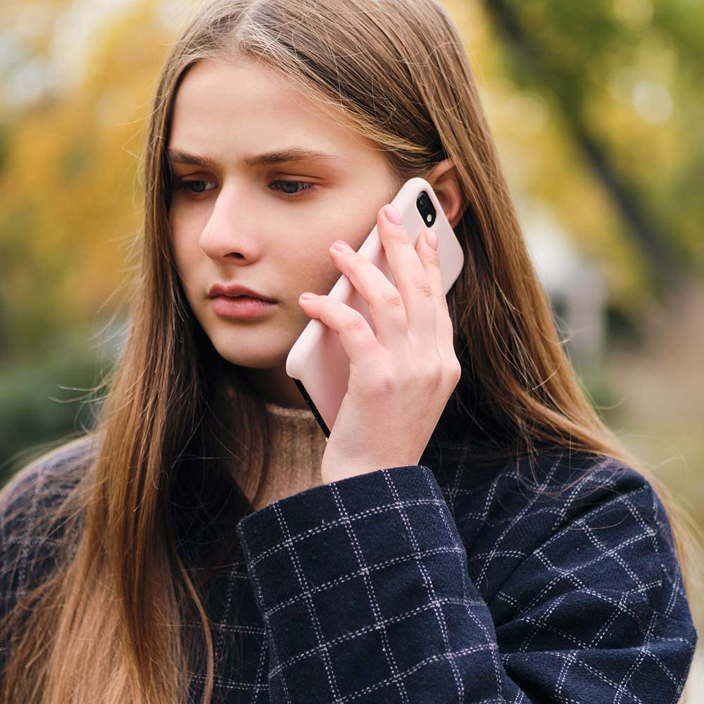 Eltham Counselling - Sad girl talking on cellphone